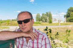 Portrait of mature Caucasian man in black sunglasses Royalty Free Stock Images