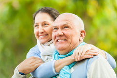 Portrait of mature couple against blured trees Royalty Free Stock Photography