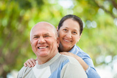 Portrait of mature couple at autumn park royalty free stock images