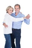 Portrait of mature couple dancing Stock Image