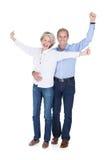 Portrait of mature couple enjoying success Stock Photos