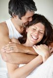 Portrait of mature couple enjoying themselves Stock Photo