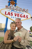 Portrait Of A Mature Couple With Money Stock Photography