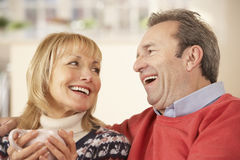 Portrait mature couple relaxing at home Stock Photos