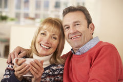Portrait mature couple relaxing at home Stock Images
