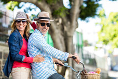 Portrait of mature couple riding bicycle Royalty Free Stock Photos