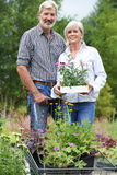 Portrait Of Mature Couple Shopping At Garden Center Royalty Free Stock Photography