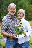 Portrait Of Mature Couple Shopping At Garden Center Royalty Free Stock Images