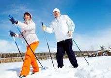 Skiing people. Portrait of mature couple skiing outside Royalty Free Stock Photography