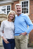 Portrait Of Mature Couple Standing Outside Home Stock Photo