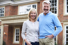 Portrait Of Mature Couple Standing Outside Home Royalty Free Stock Photo