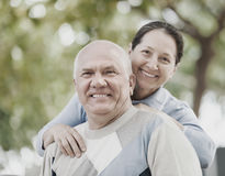 Portrait of mature couple in sweaters at autumn park Royalty Free Stock Images