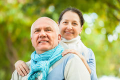 Portrait of mature couple in sweaters in a park Royalty Free Stock Photos