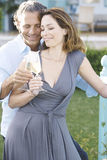 Mature couple on vinyard balcony. Stock Photos