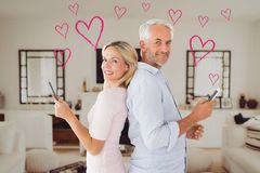 Portrait of mature couple using mobile phone Royalty Free Stock Images