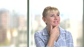 Portrait of mature daydreaming business woman. stock video footage