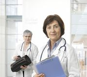 Portrait of mature female doctor at medical center Stock Photography