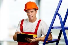 Portrait of mature foreman with clipboard. stock photo