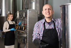 Portrait of mature friendly male brewery worker. On beer production factory Royalty Free Stock Photography
