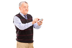Portrait of a mature gentleman writing sms Stock Photos