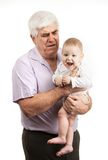 Portrait of a mature grandfather holding grandson Royalty Free Stock Photos