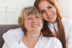 Portrait of a mature grandmother and teen granddaughter and teen Royalty Free Stock Photography