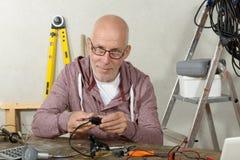Portrait of mature handyman at DIY workshop Stock Photo