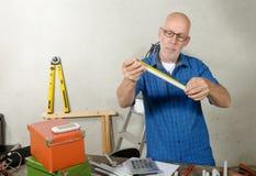 Portrait of mature handyman at DIY workshop Royalty Free Stock Photos