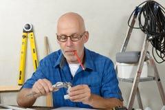 Portrait of mature handyman at DIY workshop Royalty Free Stock Images