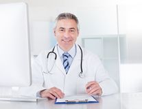 Portrait Of Mature Male Doctor Stock Photography
