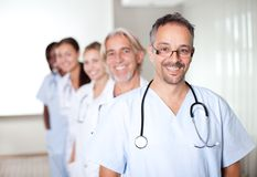 Portrait of a mature male doctor standing Stock Photography