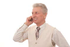 Portrait of mature man. Portrait of satisfied mature business man talking on mobile phone royalty free stock photo