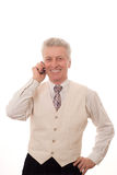 Portrait of mature man. Talking on mobile phone royalty free stock image