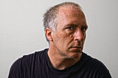 Portrait of mature man. With weathered face staring, studio background Royalty Free Stock Photo