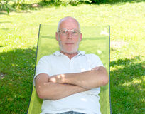 Portrait of mature man with arms crossed Stock Photo