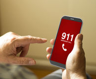 Portrait of a mature man calling emergencies number in a mobile Stock Photography