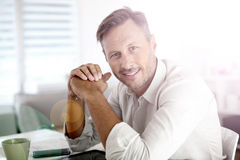 Portrait of mature man with a cup of coffee royalty free stock photo