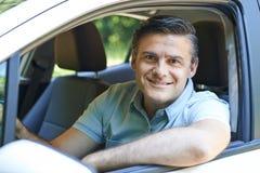 Portrait Of Mature Man Driving Car. Portrait Of Smiling Mature Man Driving Car Royalty Free Stock Image
