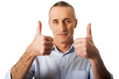 Portrait of mature man gesturing ok sign.  Royalty Free Stock Image