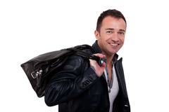 Portrait of a mature man with a handbag Royalty Free Stock Images