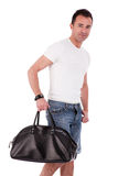 Portrait of a mature man with a handbag Royalty Free Stock Image