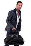 Portrait of a mature man with a handbag Royalty Free Stock Photography