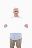 Portrait of a mature man holding a blank panel Stock Photography