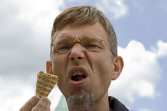 Portrait of a mature man with ice cream cone Royalty Free Stock Image