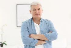Portrait of mature man indoors. Portrait of stylish mature man indoors stock photo