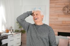 Portrait of mature man laughing. At home royalty free stock image