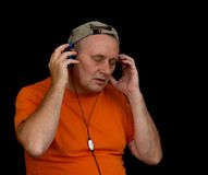 Portrait of mature man listening music Royalty Free Stock Photos