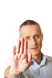 Portrait of mature man making stop sign with hand Stock Image