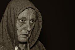 Portrait of mature man meditating in darkness Stock Photos