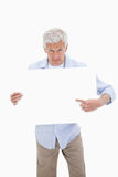 Portrait of a mature man pointing at a blank board Stock Images